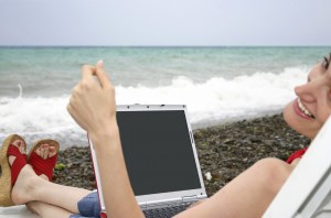 Woman relaxing with laptop, Payroll in Nashville, Tennessee and surrounding